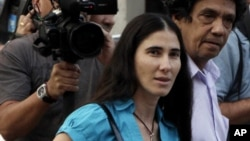 "Yoani Sanchez, who writes the ""Generation Y"" blog, center, walks with her husband Reinaldo Escobar in Havana, Cuba, Wednesday March 30, 2011. (AP Photo/Franklin Reyes)"