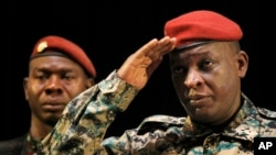 FILE - Guinea's General Sekouba Konate salutes after addressing presidential candidates and elections officials in this 2010 photo. Konate faces up to five years in prison for smuggling tens of thousands of dollars into the US.