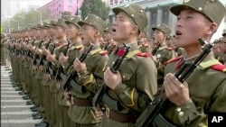 In this image made from video broadcast by North Korean broadcaster KRT, soldiers take part in a parade at Kim Il Sung Square in Pyongyang, April 15, 2017. North Korean leader Kim Jong Un has appeared in a massive parade in the capital, Pyongyang, celebra