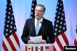 FILE - U.S. Trade Representative Robert Lighthizer talks to reporters at the end of the second round of NAFTA talks in Mexico City, Sept. 5, 2017.