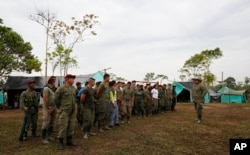 Revolutionary Armed Forces of Colombia, FARC, gather at their camp in La Carmelita near Puerto Asis in Colombia's southwestern state of Putumayo, Wednesday, March 1, 2017. March 1 was the deadline for the FARC to turn over 30 percent of their arms. But logistical delays setting up the rural camps where rebels are gathered has slowed the process.