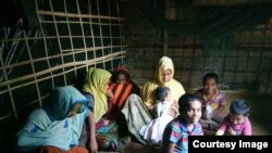 Samsun Nahar, a Rohingya widow, and her 9 children in their bamboo-and-plastic shack in a refugee colony in Kutupalong, Cox's Bazar, Bangladesh. Nahar is looking for grooms for her 13 and 14-year old daughters. (Photo by Noor Hossain)