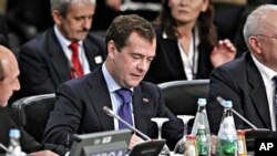 Russian President Dmitry Medvedev, center, participates at the start of the NATO Russia Council Meeting Working Session at the NATO Summit in Lisbon, Portugal, 20 Nov. 2010