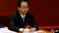 FILE - In this photo taken, Nov. 8, 2012, Ling Jihua, a loyal aide and confidante to then President Hu Jintao, attends the opening session of the 18th Communist Party Congress held at the Great Hall of the People in Beijing, China.