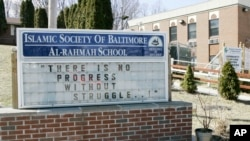 FILE - A sign outside the Islamic Society of Baltimore's Al-Rahmah School.