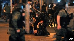 Police arrest protesters after clashes during a protest in Skopje, Macedonia, May 5, 2015.