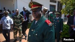 FILE - Guinea-Bissau armed forces chief-of-staff General Antonio Indjai (C) leaves a meeting with the president and the regional body of the Economic Community of West African States (ECOWAS) in the capital Bissau, Nov. 7, 2012.