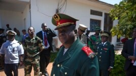 Guinea-Bissau armed forces chief-of-staff General Antonio Indjai (C) leaves a meeting with the president and the regional body of the Economic Community of West African States (ECOWAS) in the capital Bissau, Nov. 7, 2012.