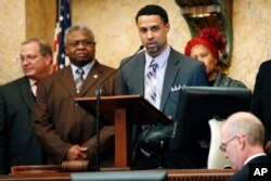 Reps. Jeffrey Guice, R-Ocean Springs, left, and Billy Broomfield, D-Moss Point, second from left, listen as former basketball player Mahmoud Abdul-Rauf expresses his thanks for being honored by the Mississippi House with a resolution noting his athletic endeavors, Feb. 26, 2013, at the Capitol in Jackson, Miss.