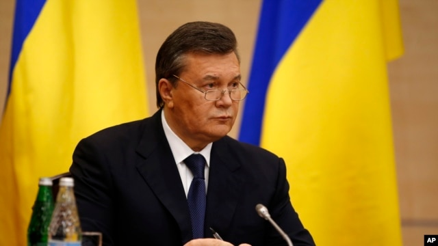 Ukraine's ousted President Viktor Yanukovych speaks at a news conference in Rostov-on-Don, a city in southern Russia, Friday, February 28, 2014.  (AP Photo/Pavel Golovkin)