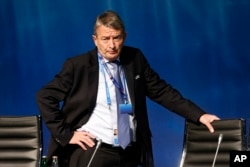 FILE - Former president of the German Soccer Federation DFB, Wolfgang Niersbach, waits for the beginning of a UEFA meeting in Zurich, Switzerland on Feb. 25, 2016.