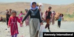 """Amnesty International keçən illərdə Suriya və İraqda müxtəlif qrupların """"etnik təmizləmə"""" apardığına dair hesabatlar yayımlayıb."""