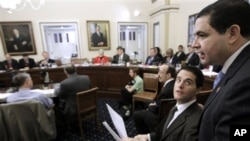 Representative Henry Cuellar, right, walks into the House Rules Committee meeting, on Capitol Hill in Washington, regarding floor debate on legislation that would repeal the health care overhaul bill, 6 Jan 2011
