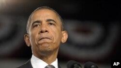 Barack Obama cédant à l'émotion, le 20 juillet 2012, en parlant du massacre d'Aurora, au Colorado. (AP Photo/Susan Walsh)