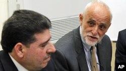 国际红十字会负责人凯伦伯格(右)和叙利亚卫生部长哈尔其在大马士革会晤