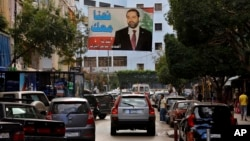 A poster of outgoing Prime Minister Saad Hariri hangs on a street in Beirut, Lebanon, Nov. 6, 2017.