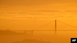A blanket of fog is seen behind the Golden Gate Bridge and Alcatraz Island as the sun sets Sunday, Feb. 28, 2016, in Berkely, Calif. The San Francisco Bay area is one of the most expensive areas to live in the world.