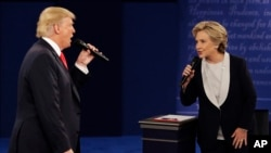 FILE - In this Sunday, Oct. 9, 2016, file photo, Republican presidential nominee Donald Trump and Democratic presidential nominee Hillary Clinton speak during the second presidential debate at Washington University in St. Louis.