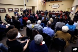 FILE - Ferguson residents pack the council chambers for a meeting of the City Council in Ferguson, Missouri, Feb. 2, 2016.
