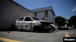 A burnt car in which a body was found during searches for the Greek Ambassador for Brazil Kyriakos Amiridis, is pictured at a police station in Belford Roxo, Brazil December 30, 2016.