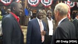 Kenya's opposition leader Raila Odinga speaking to U.S. Ambassador Robert Godec during an election results watch breakfast at the ambassador's home in Nairobi, Nov. 9, 2016.