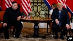 FILE - President Donald Trump meets North Korean leader Kim Jong Un in Hanoi., Feb. 28, 2019.