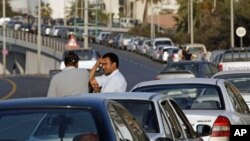 Drivers talk as they wait for fuel in a queue stretching for some hundreds of meters, in central Tripoli, Libya, (File)