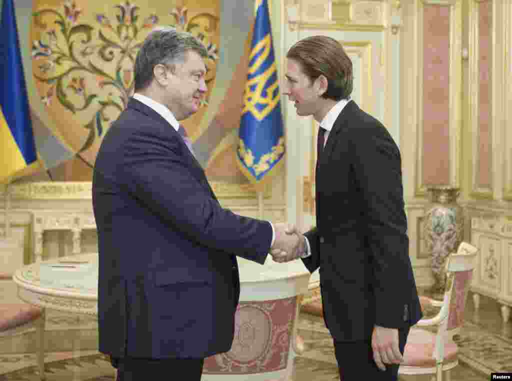 Ukrainain President Petro Poroshenko (left) shakes hands with Austrian Foreign and Integration Minister Sebastian Kurz during a meeting in Kyiv, Sept. 15, 2014.