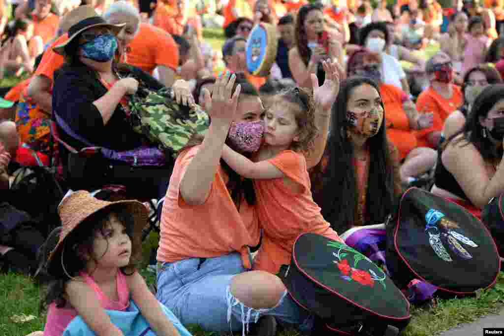People listen to speakers after the remains of 215 children, some as young as three years old, were found at the former Kamloops Indian Residential School, during a vigil in Vancouver, British Columbia, Canada, June 2, 2021.