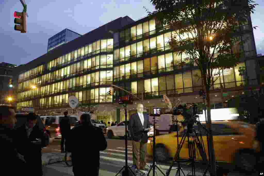 Television crews at work in front of the Bellevue Hospital after Dr. Craig Spencer, a resident of New York City and a member of Doctors Without Borders, was recently admitted, New York City, Oct. 24, 2014.
