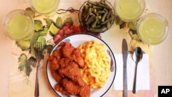 "This undated photo provided by the National Institutes of Health in June 2019 shows an ""ultra-processed"" lunch including brand name macaroni and cheese, chicken tenders, canned green beans and diet lemonade. (Paule Joseph, Shavonne Pocock/NIH via AP)"