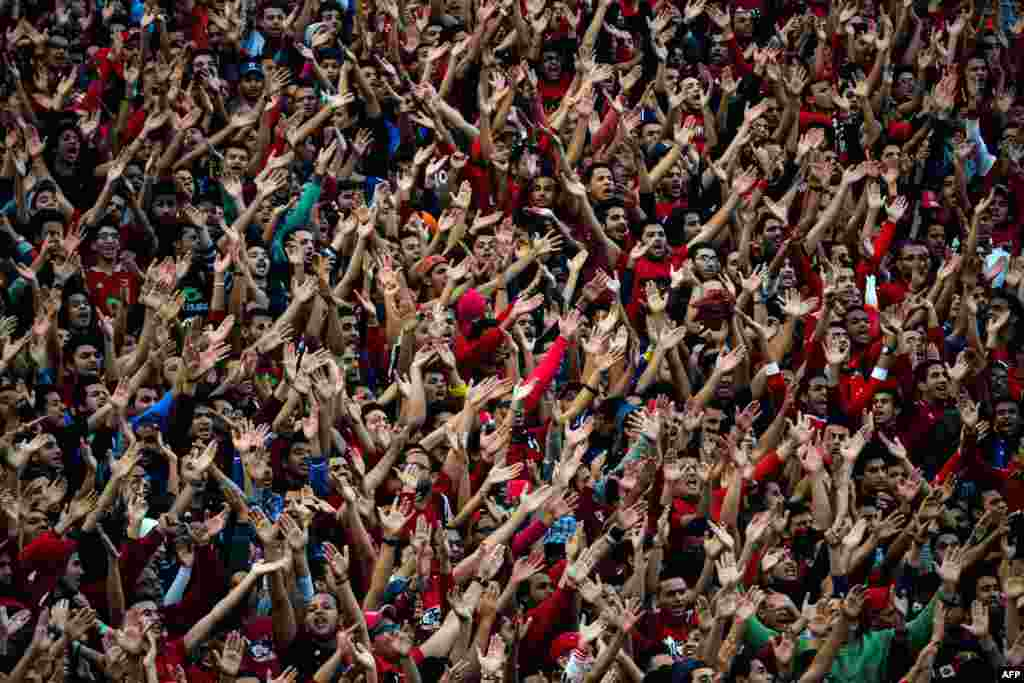 Egypt Al-Ahly fans chant slogans in support of their team ahead of the African Super Cup final football match against Tunisia's Club Sportif Sfaxien in Cairo.
