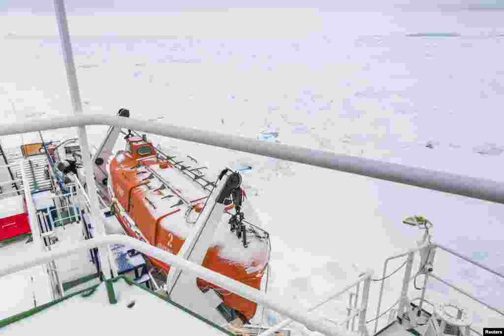 A thin coat of snow covers the deck of the MV Akademik Shokalskiy, Antarctica, Dec. 29, 2013.