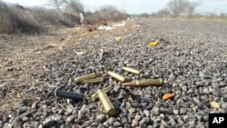 FILE - Spent bullet casing litter a road after authorities reported a gun battle with armed men near the beach resort of Mazatlan, Mexico, July 1, 2017.