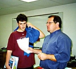 Michael Blair sedang mengajar bahasa Inggris bagi kelas sembilan khusus laki-laki.