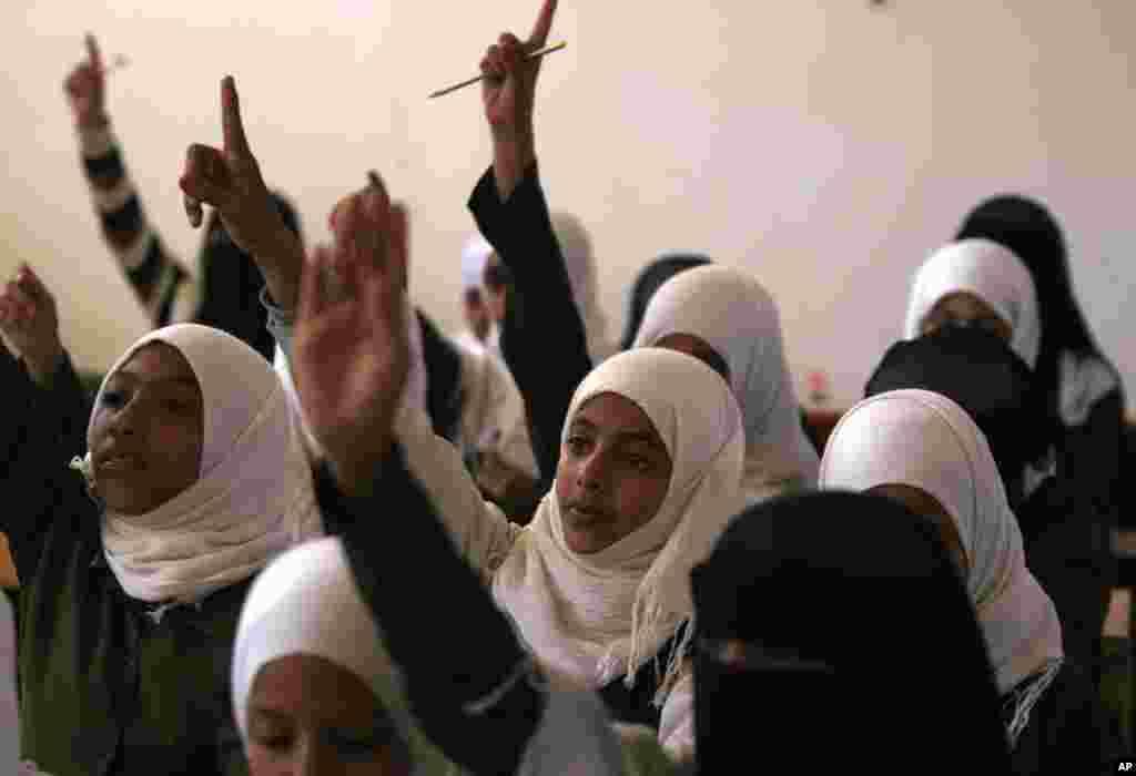 Yemeni girls attend school on the first International Day of the Girl Child, in Sanaa, Yemen, October 11, 2012.
