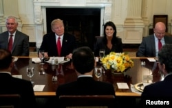 FILE - U.S. President Donald Trump, seated with then-Secretary of State Rex Tillerson, U.S. Ambassador to the United Nations Nikki Haley and then-U.S. National Security Adviser H.R. McMaster, hosts a lunch for ambassadors to the United Nations Security Council, at the White House in Washington, Jan. 29, 2018.