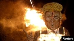 An effigy of U.S. Republican presidential candidate Donald Trump is burned as part of Bonfire Night celebrations in Edenbridge, England, Nov. 5, 2016.
