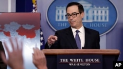 Treasury Secretary Steven Mnuchin calls on a reporter to ask a question during a press briefing at the White House, Jan. 28, 2019, in Washington.