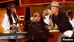 "FILE - Stevie Wonder (C) performs the Daft Punk's song ""Get Lucky"" with Pharrell Williams and Nile Rodgers (L) at the 56th annual Grammy Awards in Los Angeles, Jan. 26, 2014"