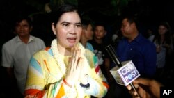 A prominent leader of Cambodia's land rights activist Tep Vanny, upon arrival at her home in Boeung Kak, in Phnom Penh, Aug. 20, 2018.