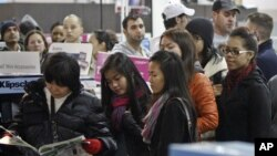 Customers wait in line to shop for 'Black Friday' discounts at a Best Buy store on Nov. 23, 2012 in Philadelphia, Pennslyvania.