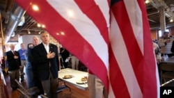 Republican 2012 presidential candidate, former Utah Gov. Jon Huntsman says the Pledge of Allegiance at the Laconia Rotary luncheon in Laconia, New Hampshire, Thursday, Dec. 29, 2011.
