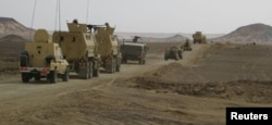 FILE - Egyptian Army vehicles are seen in the troubled northern part of the Sinai Peninsula during a launch of a major assault against militants, in Al Arish, Egypt, in this undated handout picture made available by the Ministry of Defense, March 4, 2018.