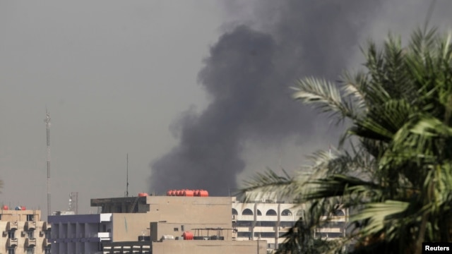 Smoke rises from the site of a bomb attack in central Baghdad, Sept. 18, 2013.