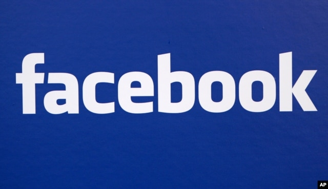 FILE - Facebook logo is displayed at a Facebook announcement in New York.