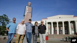 The Waldos, from left, Mark Gravitch, Larry Schwartz, Dave Reddix, Steve Capper and Jeffrey Noel pose below a statue of Louis Pasteur at San Rafael High School in San Rafael, California, April 13, 2018. Friday is April 20, or 4/20. That's the numerical code for marijuana's high holiday, a celebration and homage to pot's enduring and universal slang for smoking. And the five Northern California high school stoner buddies widely credited with creating the shorthand slang for getting high nearly 50 years ago now serve as the day's unofficial grand masters.