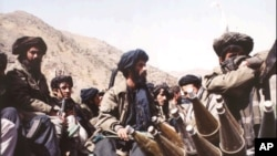 FILE - Taliban fighters near Kabul.