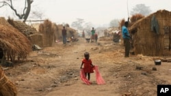 FILE - A child walks through a refugee camp in Kaga-Bandoro, Central African Republic, Feb. 16, 2016.