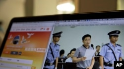 A photo described as the trial showing human rights lawyer Xie Yang which is seen on the social media of the Changsha Intermediate People's Court is shown on a computer in Beijing, May 8, 2017.